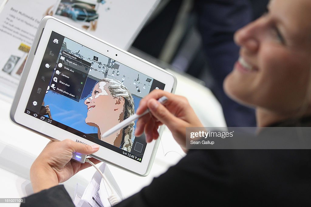 A visitor takes delight in a live image of herself on a Samsung Galaxy Note 10.1 tablet during a press day at the Samsung stand at the IFA 2012 consumer electronics trade fair on August 30, 2012 in Berlin, Germany. IFA 2012 will be open to the public from August 31 through September 5.