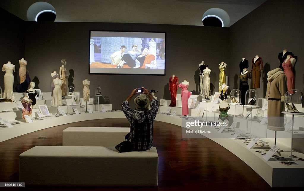 A visitor takes photos during a press preview of the 'Marilyn' exhibition at Prague Castle on May 29, 2013 in Prague, Czech Republic. The exhibition was created by the Museo Salvatore Ferragamo in Florence, in 2012. Marilyn Monroe loved and owned many pairs of shoes made by Ferragamo. The Marilyn exhibition, which commemorates the 50th anniversary of her death, runs at the Riding School until September 20, 2013. The exhibition will present 30 pairs of shoes and over 50 outfits and other accessories from Marylin's personal, public and movie wardrobe and also historical movie clips, magazine covers and Marilyn's original writings.