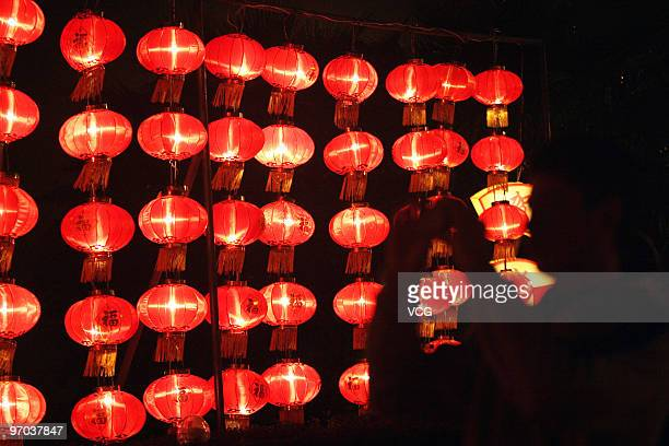 A visitor takes photos of the lantern decorations for Lantern Festival on February 24 2010 in Fuzhou Fujian Province of China The lantern festival...