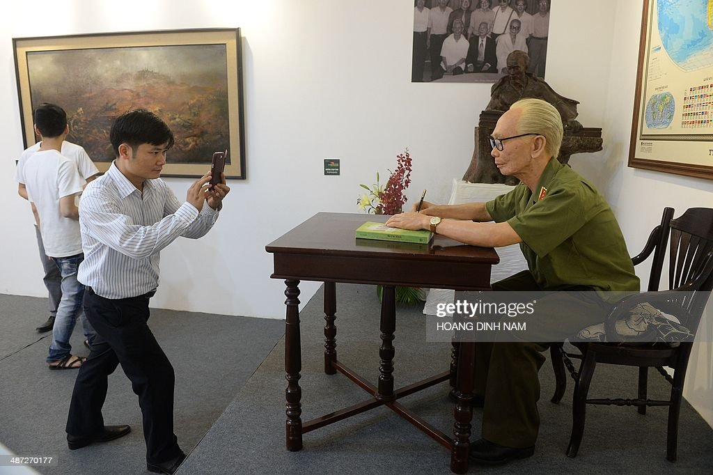 A visitor takes picture of a silicon life-size statue of late General Vo Nguyen Giap whose troops defeated French at Dien Bien Phu battlefield in 1954, at an exhibition held at Hanoi's Army Museum on April 29, 2014. Vietnam will celebrate next week the 60th anniversary of the Dien Bien Phu battle.