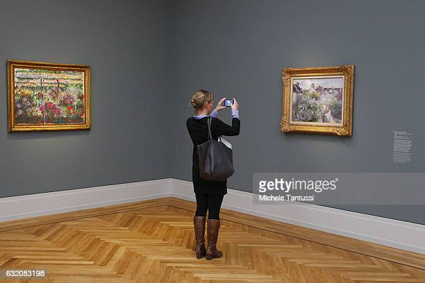 Visitor takes pictures in the museum's exhibition spaces during a press preview in Barberini Museum on January 19 2017 in Potsdam Germany The art...