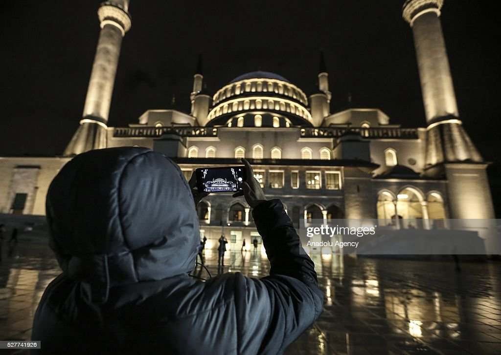 A visitor takes pictures of the Kocatepe Mosque during Miraj Night or Lailat al Miraj, one of the Muslims' five holiest night around a year, on May 3, 2016 in Ankara, Turkey.