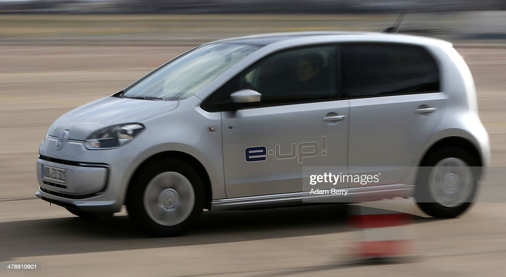 A visitor test drives a Volkswagen e-up! automobile at the Electric Mobility Week (e-Mobilitaetswochen), a public Volkswagen (VW) event at the former Tempelhof airport, on March 15, 2014 in Berlin, Germany. The event was designed to promote the company's e-Golf und e-up! automobiles, as well as its other alternative energy powered vehicles.