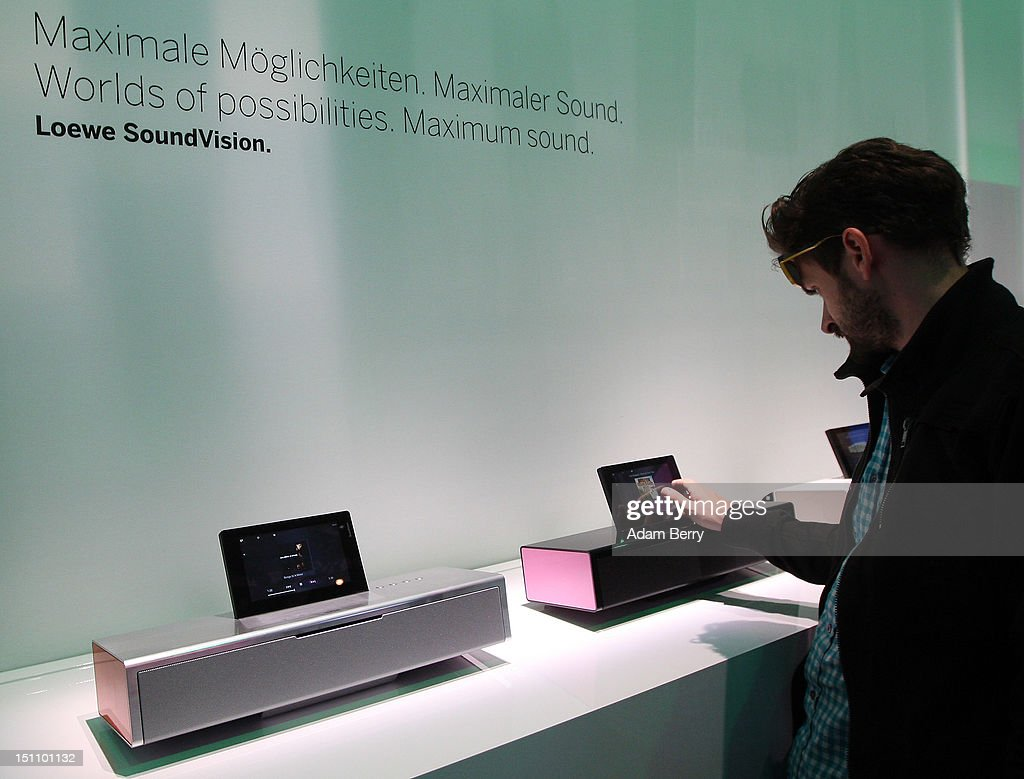 A visitor tests a Loewe SoundVision speaker on display at the Internationale Funkausstellung (IFA) 2012 consumer electronics trade fair on September 1, 2012 in Berlin, Germany. IFA 2012 is open to the public from today until September 5.
