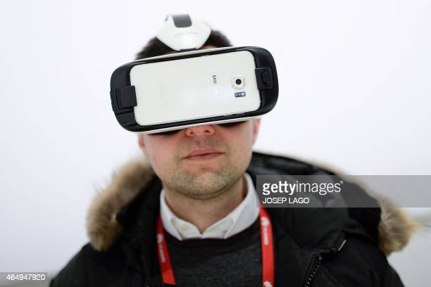 A visitor tests a Samsung Gear VR during the opening day of the 2015 Mobile World Congress in Barcelona on March 2 2015 Phone makers will seek to...