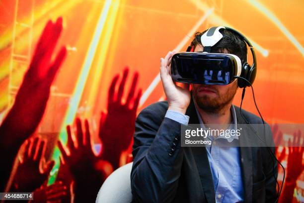 A visitor tests a Samsung Gear VR virtual reality headset developed jointly by Oculus VR Inc and Samsung Electronics Co at the IFA Consumer...