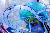 A visitor tests a water slide in the newly relaunch National Aquatics Center better known as the Water Cube in Beijing on August 8 2010 Adults have...