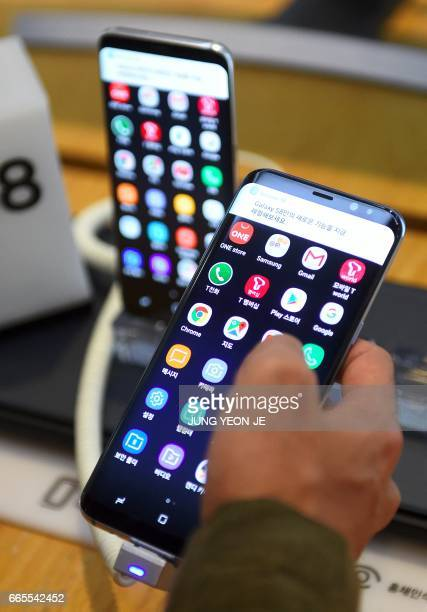 A visitor tests Samsung's new smartphone Galaxy S8 at a Samsung showroom in Seoul on April 7 2017 Samsung Electronics said on April 7 it expects...