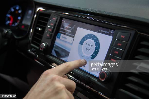 A visitor tests the app Travipay in a car with at the Mobile World Congress on the first day of the MWC in Barcelona on February 27 2017 Phone makers...