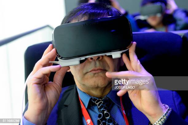 A visitor tests the new 'Oculus VR' virtual device at the Samsung stand during the Mobile World Congress in Barcelona on February 22 on the first day...