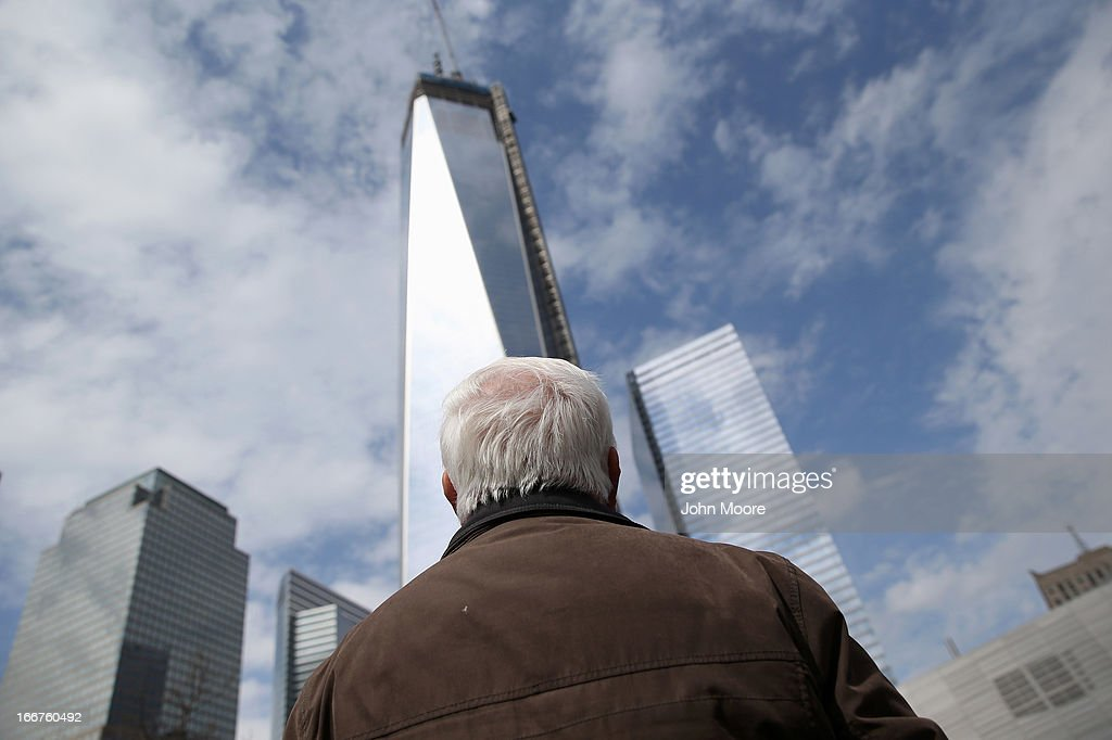 A visitor the the September 11 Memorial and Museum looks towards the One World Trade tower on April 16, 2013 in New York City. Security was high throughout New York City a day after the Boston Marathon attacks.