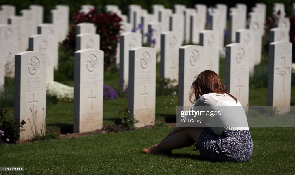 A visitor to Bayeux War Cemetery looks at the headstones for British servicemen that were killed during the Normandy campaign at a remembrance and wreath laying ceremony to commemorate the start of the D-Day landings on June 6, 2013 in Bayeux, France. Across Normandy several hundred of the surviving veterans of the Normandy campaign are gathering to commemorate the 69th anniversary of the D-Day landings which eventually led to the Allied liberation of France in 1944. Next year, which will mark the 70th anniversary of the landings, is widely expected to be the last time that the veterans will gather in any great number.