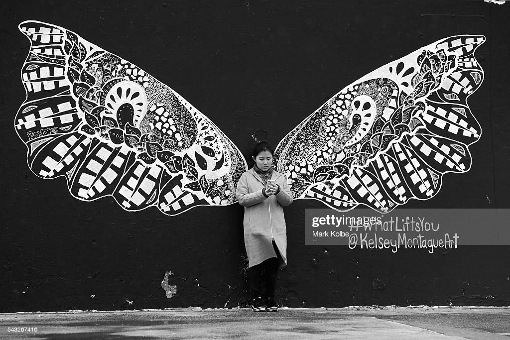 A visitor to Bondi Beach on a cold and wet day stops to take a selfie in front of a wall mural on June 27, 2016 in Sydney, Australia. Sydney experienced its coldest day of the year on Sunday, and more icy weather is forecast for later in the week when a second cold front hits later in the week.