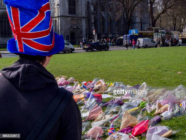A visitor to Parliament Square Garden in London where floral tributes have been left for victims of the terror attack in Westminster on the 22nd...
