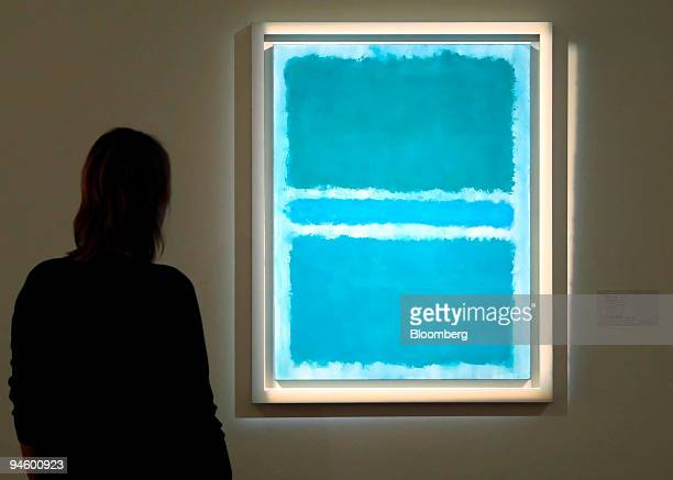 A visitor to Sotheby's October contemporary art sale highlights looks at a work by Mark Rothko entitled 'Blue Divided By Blue' in London UK on Monday...
