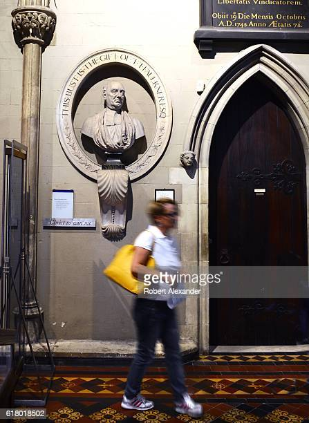 A visitor to St Patrick's Cathedral in Dublin Ireland walks past a bust of Jonathan Swift who was the cathedral's dean from 1713 until his death in...