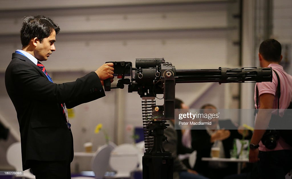 A visitor to the Defence and Security Exhibition looks at a gun on September 10, 2013 in London, England. ExCeL London is hosting the exhibition with hundreds of manufacturers from all over the world displaying their hardware.