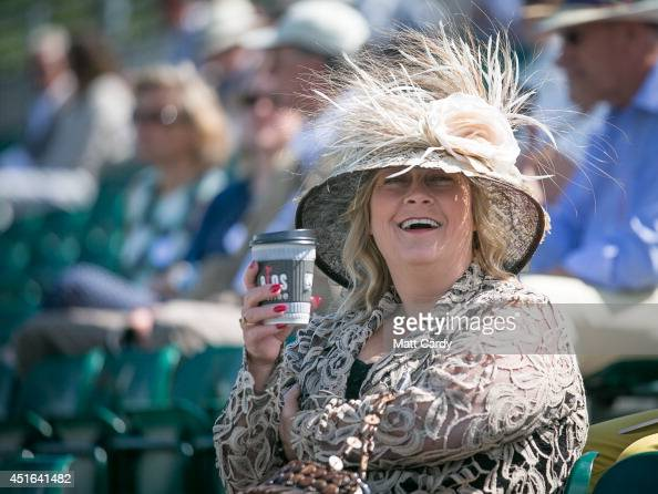 A visitor to the Henley Royal Regatta reacts as she watches the races on July 3 2014 in HenleyonThames England Opening yesterday and celebrating its...