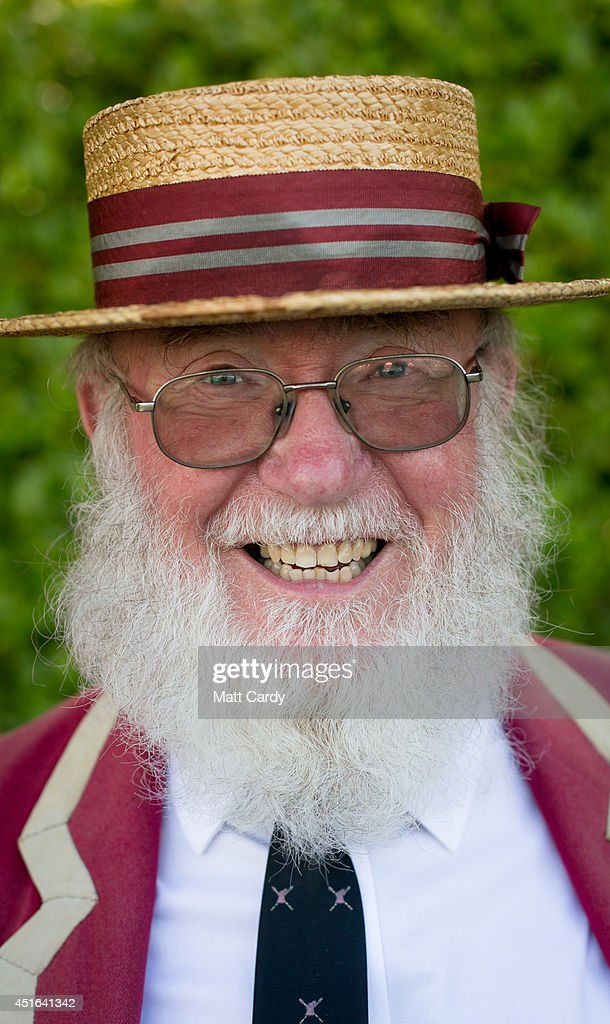A visitor to the Henley Royal Regatta watches the races on July 3 2014 in HenleyonThames England Opening yesterday and celebrating its 175th year the...
