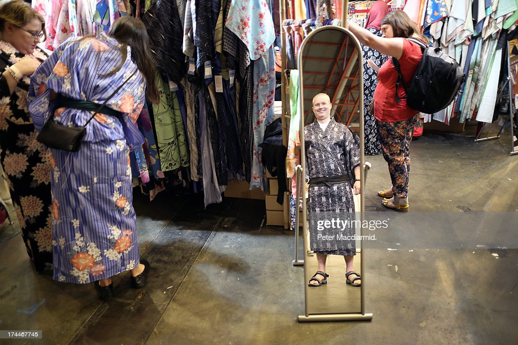 A visitor to the Hyper Japan event at Earls Court is reflected in a mirror as he tries on a kimono on July 26, 2013 in London, England. The show is the UK's biggest Japanese Culture event, with stalls selling clothing and artwork. Live music, Japanese food and computer gaming areas are also on show. Many attendees dress up as anime characters or in the lolita fashion widespread in Japan.