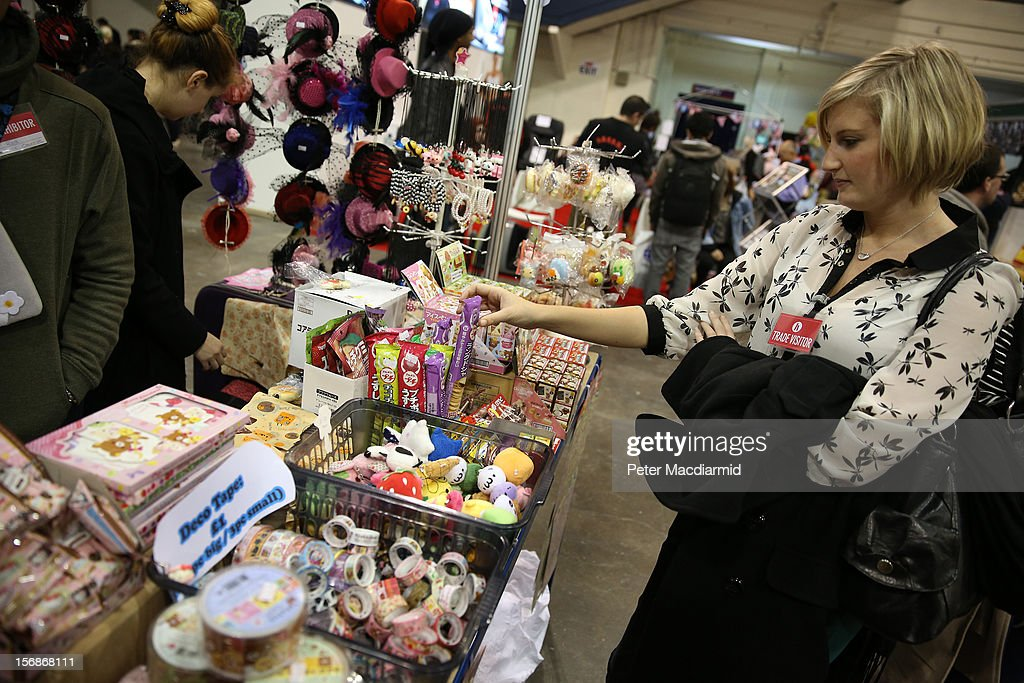 A visitor to The Hyper Japan event at Earls Court shops for bargains on November 23, 2012 in London, England. The show is the UK's biggest Japanese Culture event, with stalls selling clothing and artwork. live music, Japanese food and computer gaming areas are also on show. Many attendees dress up as anime characters or in the lolita fashion widespread in Japan.