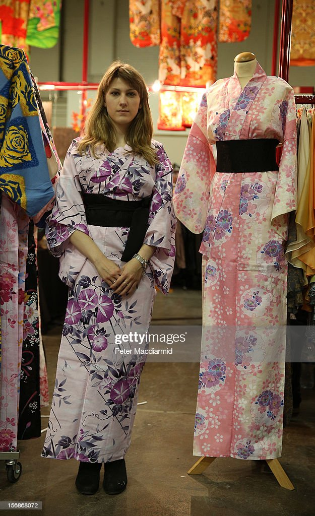 A visitor to The Hyper Japan event at Earls Court tries on an outfit at a clothes stall on November 23, 2012 in London, England. The show is the UK's biggest Japanese Culture event, with stalls selling clothing and artwork. live music, Japanese food and computer gaming areas are also on show. Many attendees dress up as anime characters or in the lolita fashion widespread in Japan.
