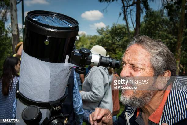A visitor to the National Autonomous University of Mexico Institute of Astronomy watches the solar eclipse through a telescope installed for the...
