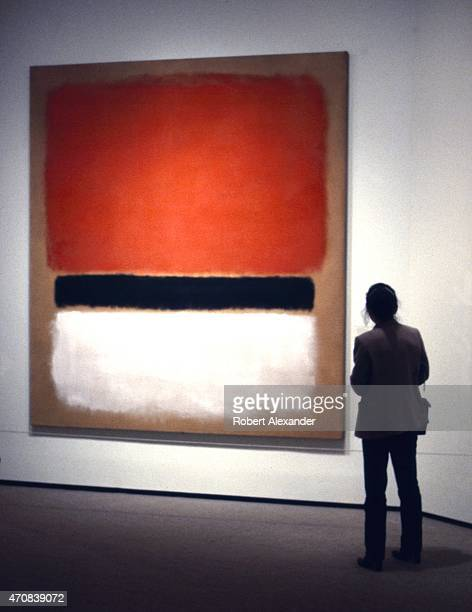 A visitor to the National Gallery of Art in Washington DC admires an untitled painting by Mark Rothko painted in 1955