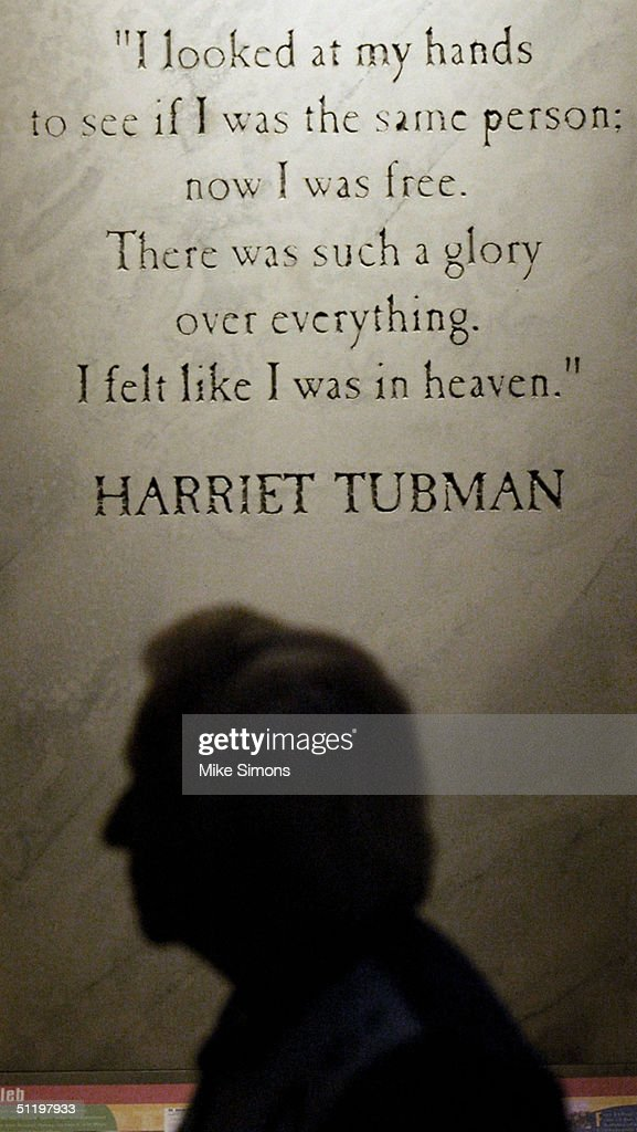 A visitor to the National Underground Railroad Freedom Center is silhouetted against a Harriet Tubman quote August 20, 2004 in Cincinnati, Ohio. The Freedom Center is open to the public, and a grand opening celebration is scheduled for August 23.
