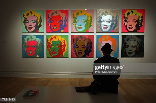 A visitor to the Pop Art Portraits exhibition at National Portrait Gallery looks at Andy Warhol's 'Marilyn Monroe 1967' on October 10 2007 in London...