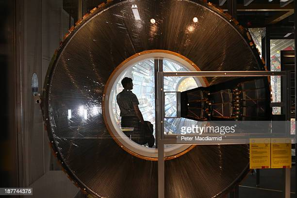 A visitor to the Science Museum is seen through a cross section of a Transition Radiation Tracker Wheel prototype part of the Large Hadron Collider...