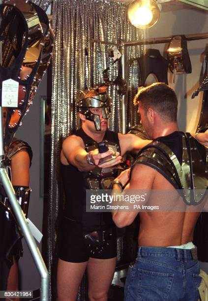 A visitor to the show trys on some 'David Spain' steel plate body armour at the Gay Life Style 2000 exhibition held at Olympia in London