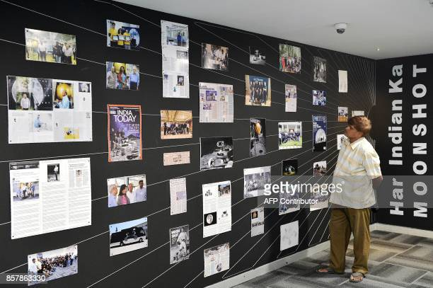 A visitor to the 'Team Indus' facility looks at a posters showcasing a timeline of achievements in the organisation's attempt for the Google Lunar X...