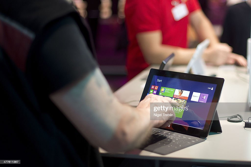 A Visitor touches a surface tablet at the Microsoft stand at the 2014 CeBIT technology Trade fair on March 10, 2014 in Hanover, Germany. CeBIT is the world's largest technology fair and this year's partner nation is Great Britain.