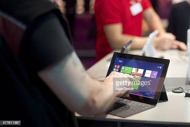 Visitor touches a surface tablet at the Microsoft stand at the 2014 CeBIT technology Trade fair on March 10 2014 in Hanover Germany CeBIT is the...