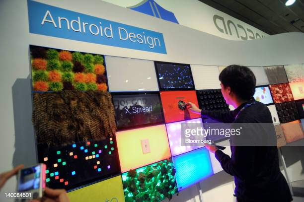A visitor touches an interactive display at the Android design booth at the Mobile World Congress in Barcelona Spain on Monday Feb 27 2012 The Mobile...