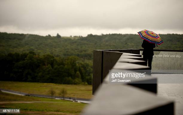 A visitor tours the plane crash site at the visitor center at the Flight 93 National Memorial on September 10 2015 in Shanksville Pennsylvania The...