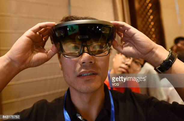 A visitor tries Microsoft's HoloLens mixed reality smartglasses during a new product experience event on September 5 2017 in Hangzhou Zhejiang...