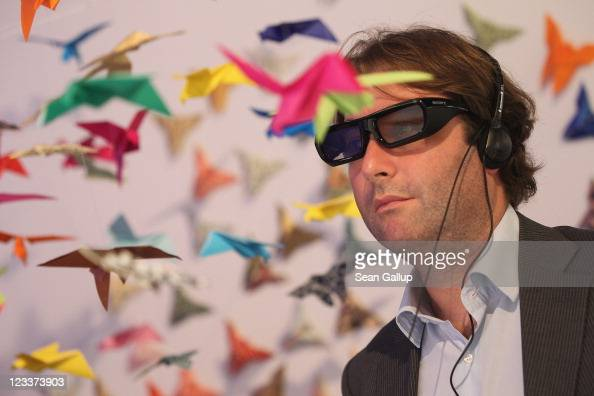 A visitor tries out a 3D presentation at the Sony stand at the IFA 2011 consumer electonics and appliances trade fair on the first day of the fair's...