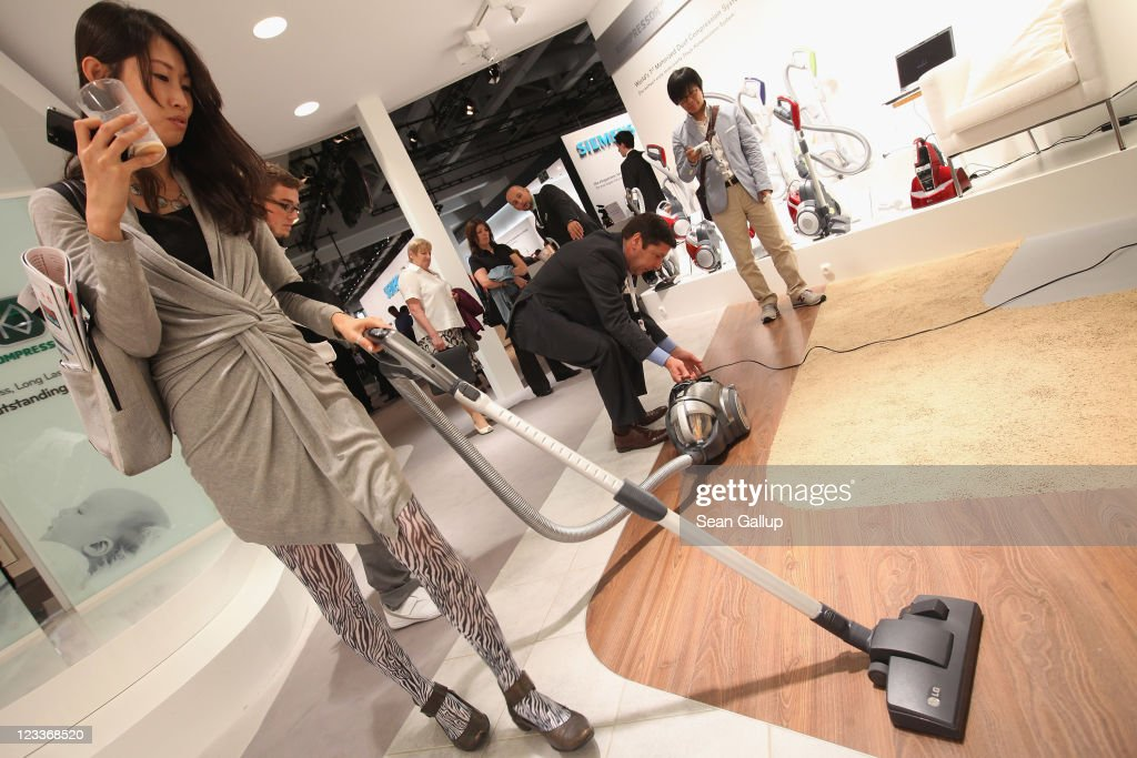 A visitor tries out a high-tech washing vacuum cleaner at the LG stand at the IFA 2011 consumer electonics and appliances trade fair on the first day of the fair's official opening on September 2, 2011 in Berlin, Germany. The IFA 2011 will be open to the public from September 2-7.