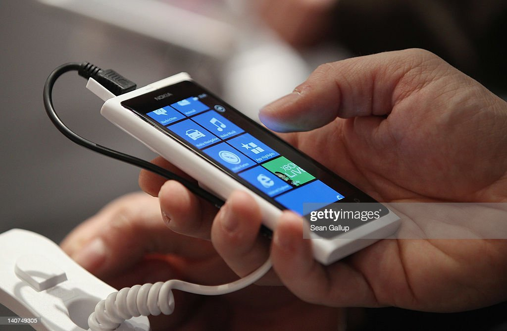 A visitor tries out a Nokia Lumia smartphone on the first day of the CeBIT 2012 technology trade fair on March 6, 2012 in Hanover, Germany. CeBIT 2012, the world's largest information technology trade fair, will run from March 6-10, and advances in cloud computing and security are major features this year.