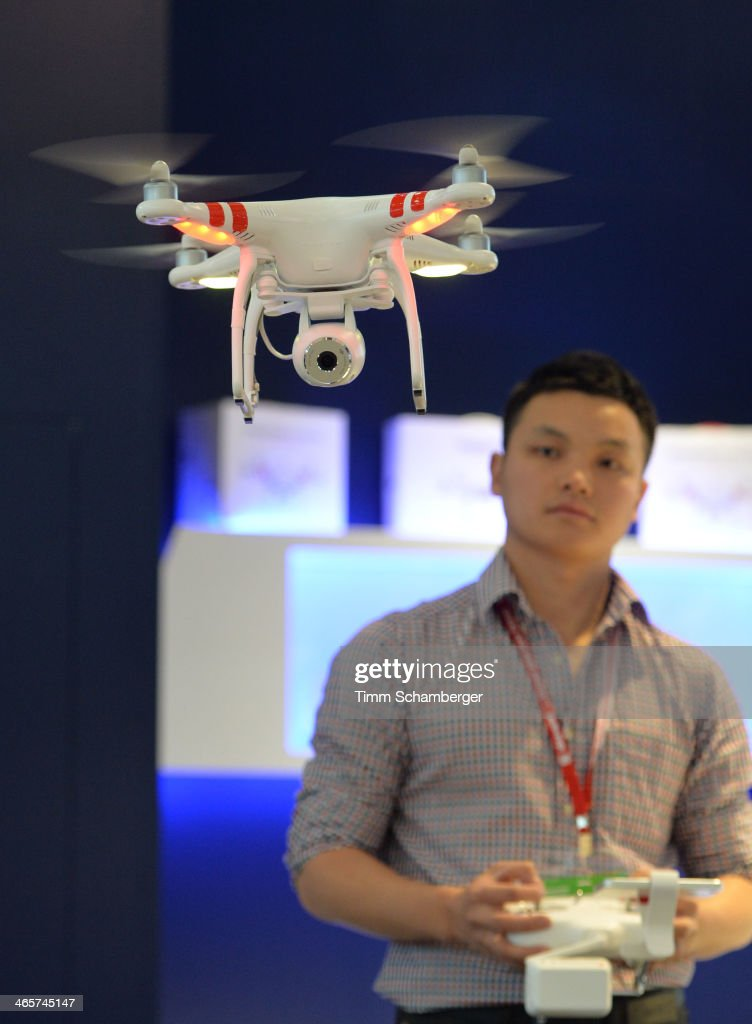A visitor tries out a remote-controlled multicopter flying toy at the Nuremberg International Toy Fair (Nuernberger Spielwarenmesse) on January 29, 2014 in Nuremberg, Germany. The Nuremberg toy fair, which is the world's biggest trade fair for toys, is open to the public from January 29 until February 3.
