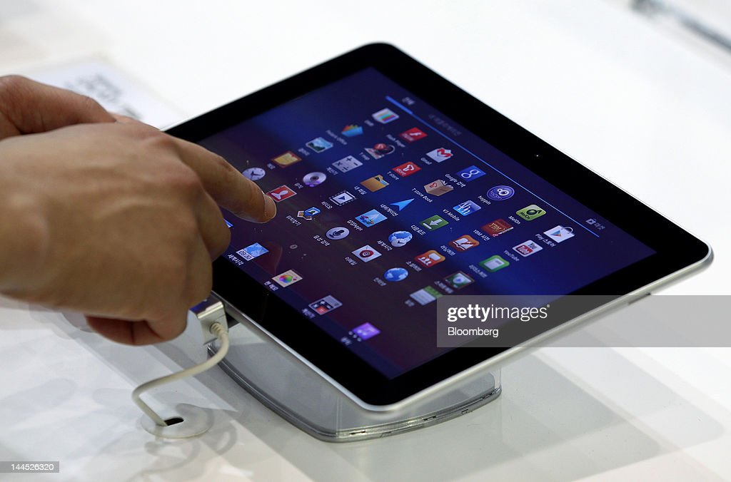 A visitor tries out a Samsung Electronics Co. Galaxy Tab 10.1 tablet computer at the World IT Show 2012 in Seoul, South Korea, on Tuesday, May 15, 2012. The show will be held through May 18. Photographer: SeongJoon Cho/Bloomberg via Getty Images