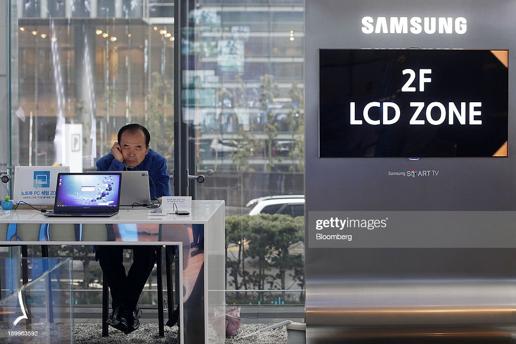 A visitor tries out a Samsung Electronics Co. Series 9 Notebook at the Samsung d'light showroom and store in Seoul, South Korea, on Wednesday, Jan. 23, 2013. Samsung, in a preliminary statement of results on Jan. 8, reported an 89 percent jump in profit in the three months ended in December, boosted by its Galaxy line of smartphones. Photographer: Woohae Cho/Bloomberg via Getty Images