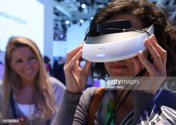 A visitor tries out a Sony HMZT2 personal 3D movie viewer during the Internationale Funkausstellung 2012 consumer electronics trade fair on August 31...