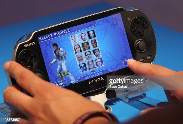 A visitor tries out a Sony PlayStation Vista gaming device at the Sony stand at the IFA 2011 consumer electonics and appliances trade fair on the...