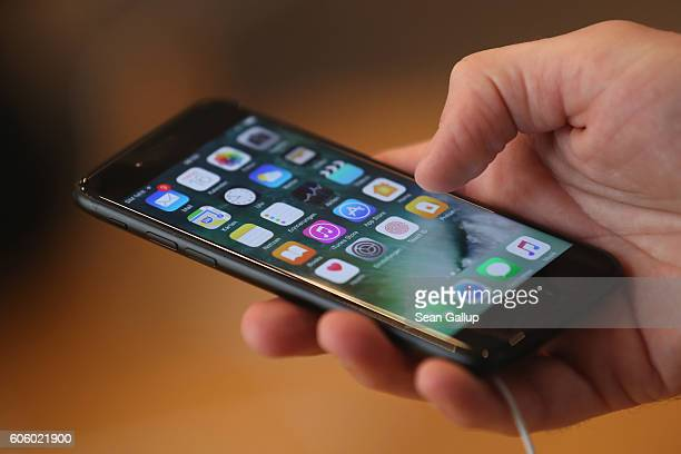 A visitor tries out an Apple iPhone 7 on the first day of sales of the new phone at the Berlin Apple store on September 16 2016 in Berlin Germany The...