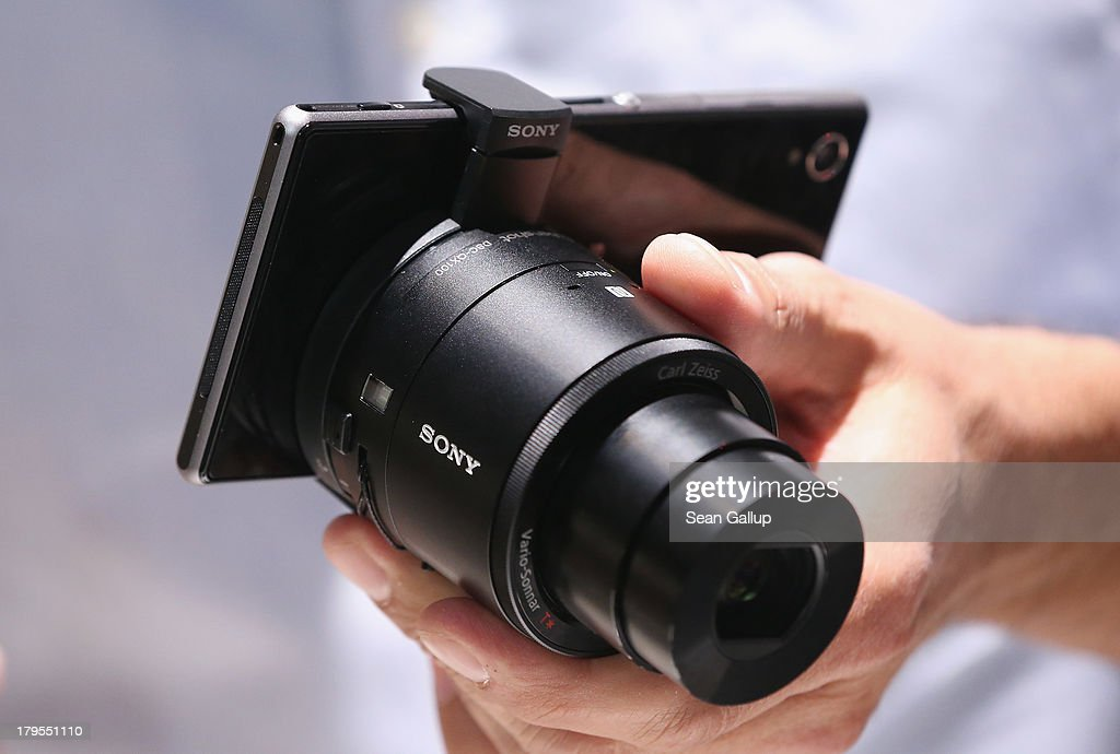 A visitor tries out an Xperia Z1 smartphone with a detachable camera lens at the Sony stand at the IFA 2013 consumer electronics trade fair on September 5, 2013 in Berlin, Germany. The 2013 IFA will be open to the public from September 6-11.