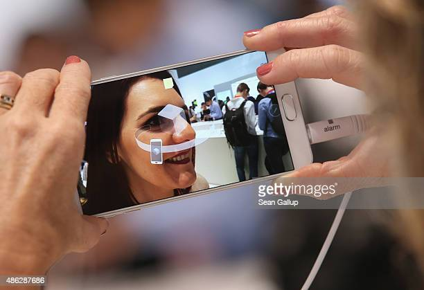 A visitor tries out the camera on a Galaxy Note 5 smartphone at the Samsung stand during a press day at the 2015 IFA consumer electronics and...