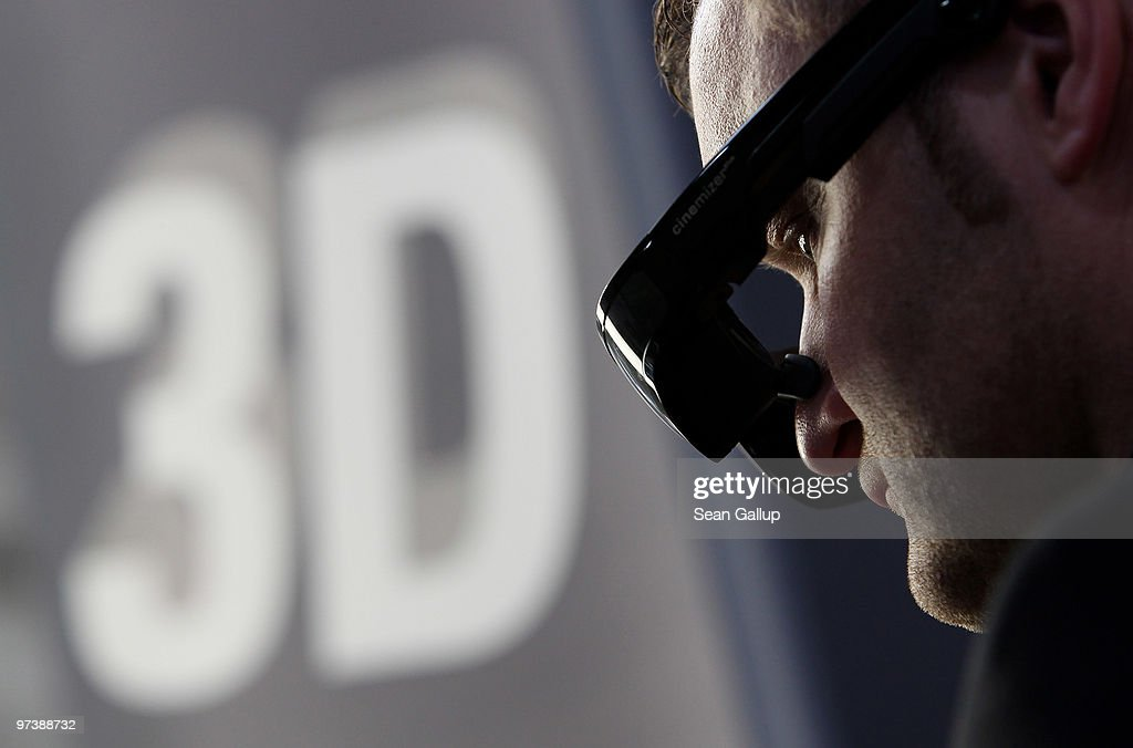 A visitor tries out the Cinemizer Plus 3D video glasses at the Carl Zeiss stand at the CeBIT Technology Fair on March 3, 2010 in Hannover, Germany. CeBIT will be open to the public from March 2 through March 6.